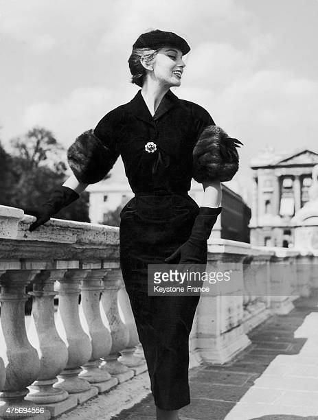 Future French singer and model Michèle Arnaud poses wearing a Chanel dress at the Place de la Concorde in Paris, France, on January 21, 1954.