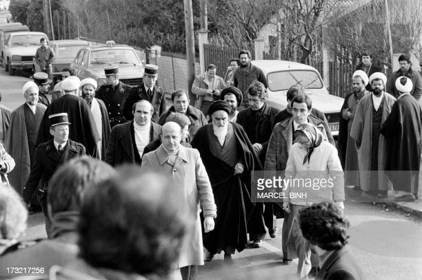 Future Iranian President Hassan Rohani is seen among companions of opposition leader in exile ayatollah Ruhollah Khomeiny walking out of his villa in...