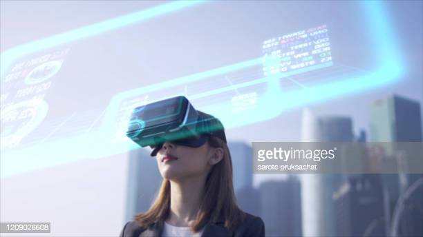future is now. woman using virtual reality device while traveling in singapore . - digital viewfinder stock pictures, royalty-free photos & images