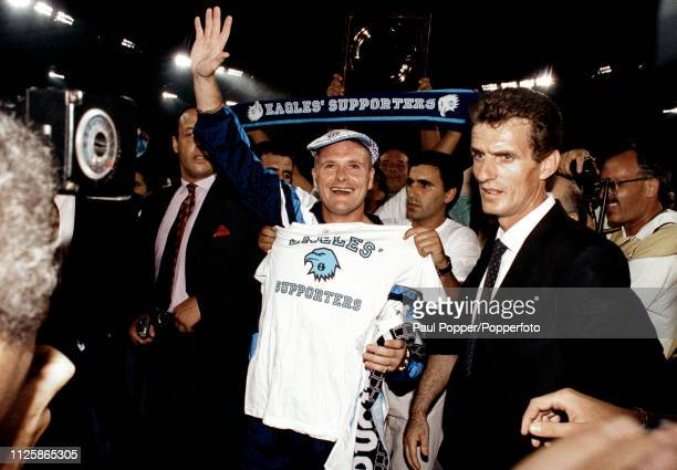 Future Lazio player Paul Gascoigne waves to the fans on his first visit to the Stadio Olimpico after his proposed move from Tottenham Hotspur on...
