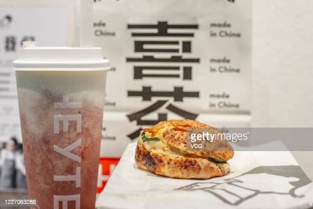 Future Meat Cheese Burger, which is made from plant-based meat, is pictured at a HEYTEA store on May 25, 2020 in Shanghai, China. Chinese tea drink...