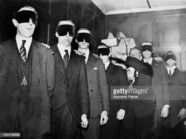 Future Members Of An English Freemasonry Lodge Being Guided With Their Eyes Covered During Their Initiation Around 1933