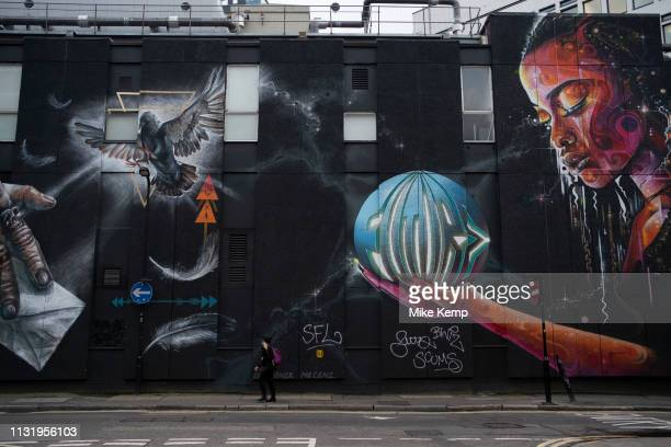 Future mural in Shoreditch in London, United Kingdom. Street art in the East End of London is an ever changing visual enigma, as the artworks...