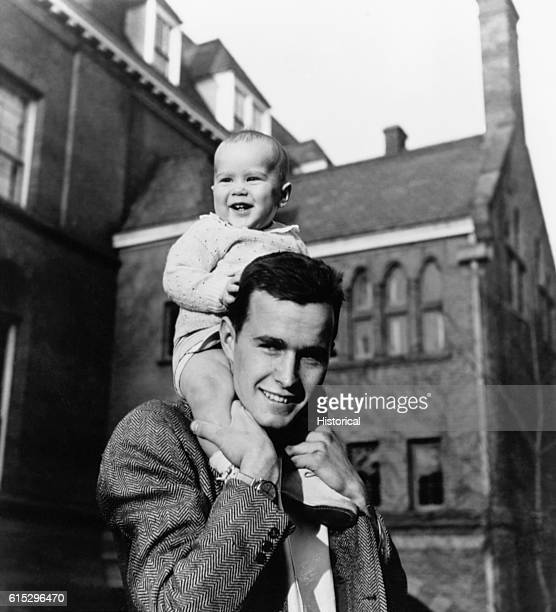 Future President George Bush carries his infant son George W Bush on his shoulders on the Yale University campus The younger Bush was elected...