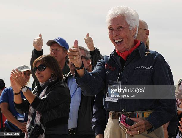Future space tourists led by Wally Funk , who have paid their deposits on the $200,000.00 fare, celebrate before the Virgin Galactic VSS Enterprise...