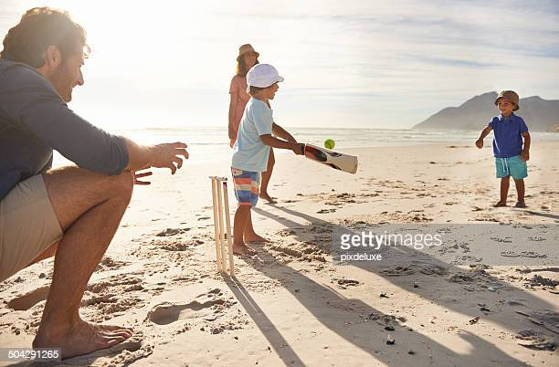 future sports stars in training - beach cricket stock pictures, royalty-free photos & images
