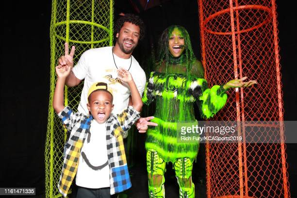 Future Zahir Wilburn Russell Wilson and Ciara smile after Ciara was slimed at Nickelodeon Kids' Choice Sports 2019 at Barker Hangar on July 11 2019...