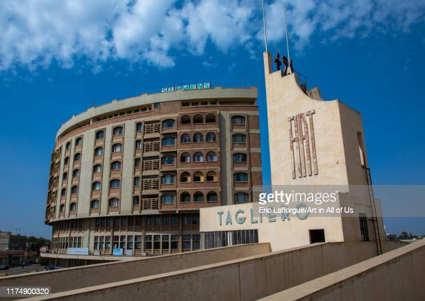 Futurist architecture of the FIAT tagliero service station built in 1938 in front of nakfa house, Central region, Asmara, Eritrea on August 22, 2019...