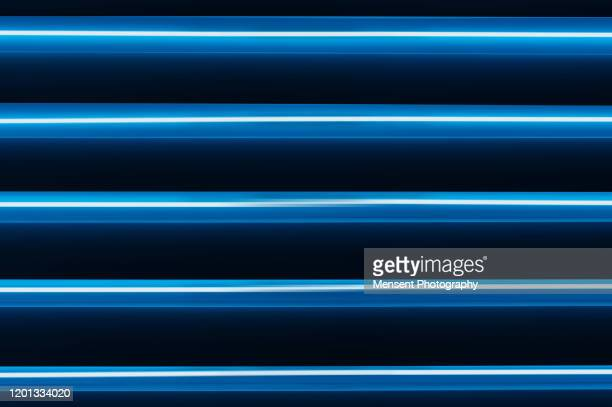 futuristic abstract colorful display of neon lights - fluorescent light stock pictures, royalty-free photos & images