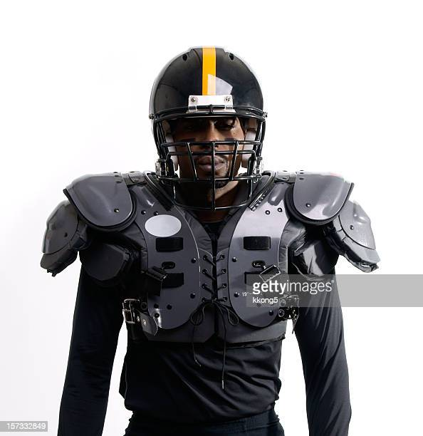 futuristic american football player with pads - padding stock pictures, royalty-free photos & images
