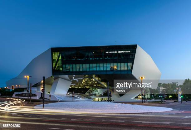 futuristic architecture night traffic blur porsche museum - stuttgart stock pictures, royalty-free photos & images