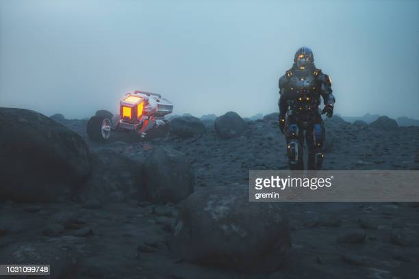 futuristic astronaut walking on alien planet - military drones stock photos and pictures