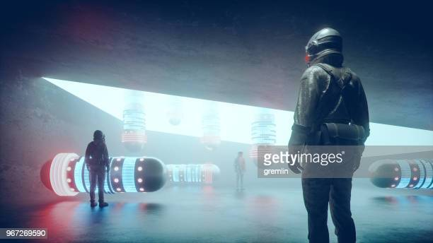 futuristic astronauts standing in front of spaceships - spaceship stock pictures, royalty-free photos & images