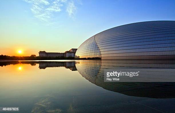 CONTENT] A futuristic building in Beijing China reflects the early morning sun across a manmade pool of crystal clear water