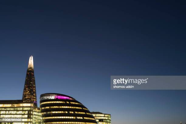futuristic buildings at dusk - architecture stock pictures, royalty-free photos & images