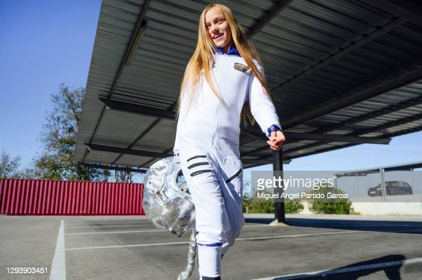 futuristic child astronaut in full-length white uniform and silver helmet outdoors. dream, future, travel and discovery concept - silver shoe stock pictures, royalty-free photos & images