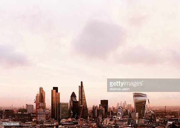 Futuristic city skyline of London at sunset