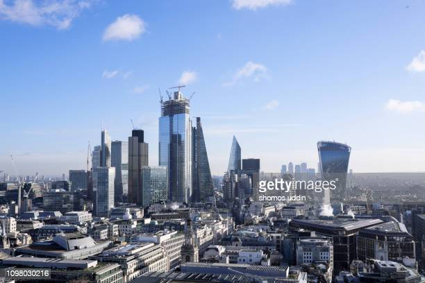 futuristic city skyline of london financial district - aerial view - canary wharf stock pictures, royalty-free photos & images