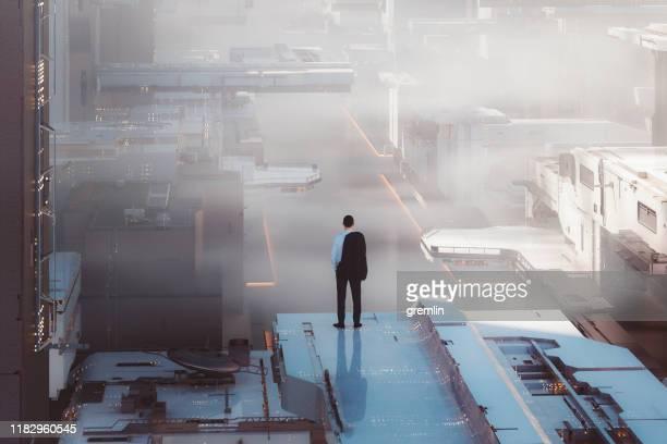 futuristische stad straat met eenzame zakenman staande hoog - prosperity stockfoto's en -beelden