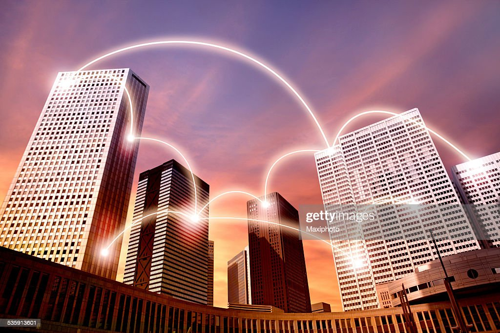 Futuristic city with buildings linked by glowing network : Stock Photo