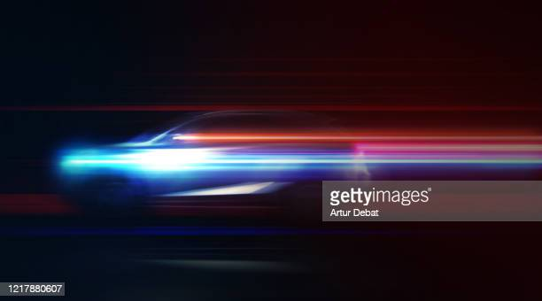 futuristic clean energy car driving fast with colorful light trails. - electric car stock pictures, royalty-free photos & images
