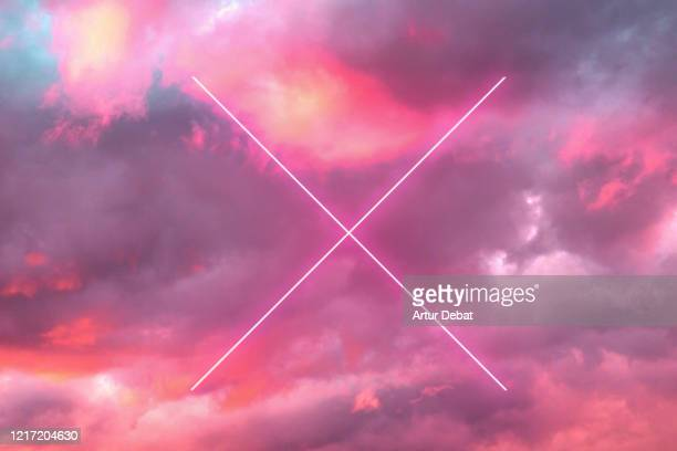 futuristic cross with neon lights in the burning sky with stunning pink colors. - nature alphabet letters stock pictures, royalty-free photos & images