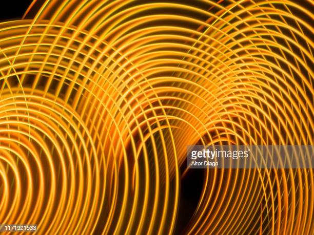 futuristic  curved lines in circular form. it could be production of fusion energy. - nuclear fusion stock pictures, royalty-free photos & images