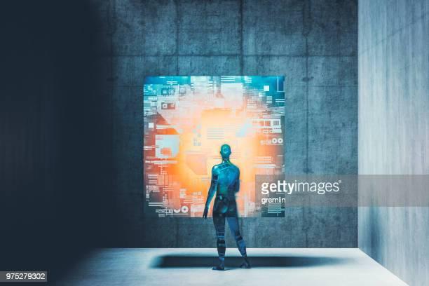 futuristische cyborg und der glühende außerirdische cube - interaktivität stock-fotos und bilder