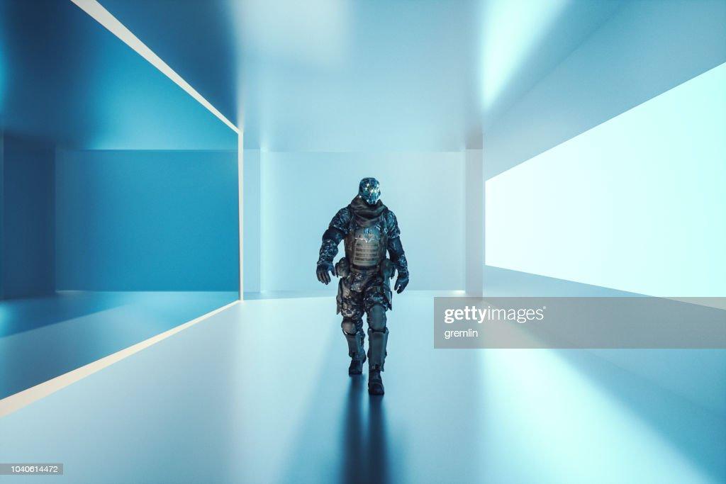 Futuristic cyborg soldier walking on alien space ship : Stock Photo