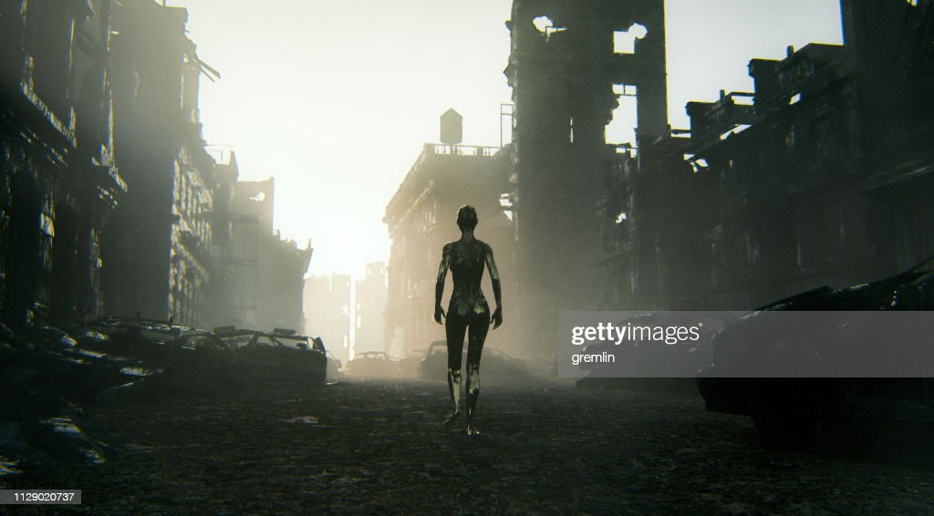 Futuristic cyborg walking in destroyed city : Stock Photo