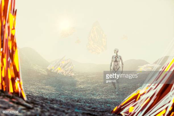 futuristic cyborg walking on rocky alien planet - extrasolar planet stock pictures, royalty-free photos & images