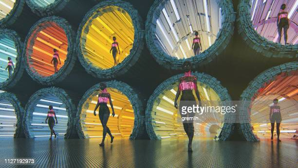 futuristic cyborgs walking in the city - cloning stock pictures, royalty-free photos & images