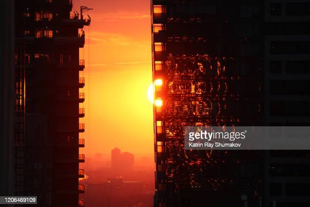 futuristic, dramatic sunset between the city giants - architectural feature stock pictures, royalty-free photos & images