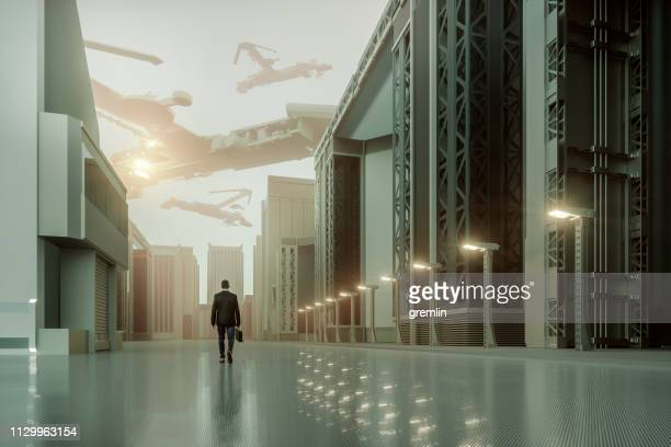 futuristic dystopian city with walking businessman - doom patrol stock photos and pictures