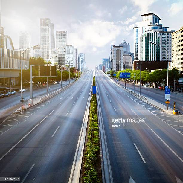 futuristic empty green city - urban road stock pictures, royalty-free photos & images