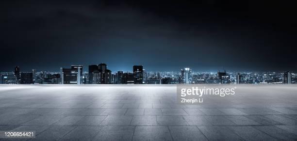 futuristic empty parking ground with urban city skyline high res panorama - city life ストックフォトと画像