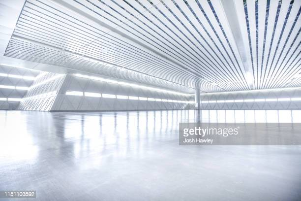 futuristic empty room, 3d rendering - indoors stock-fotos und bilder