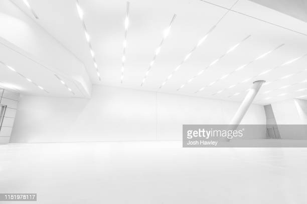futuristic empty room, 3d rendering - showroom stock pictures, royalty-free photos & images