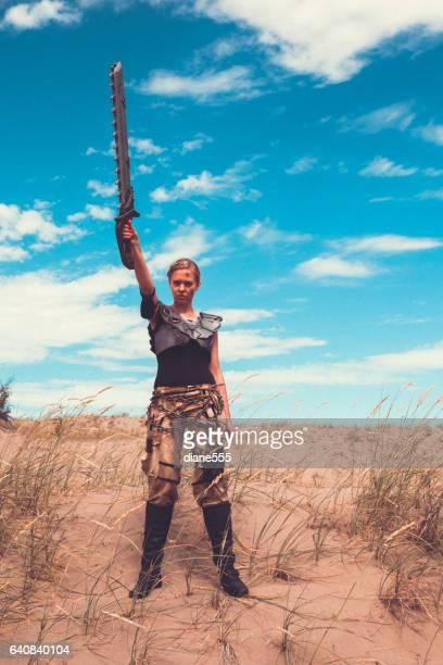 Futuristic Female Warrior Standing In The Desert