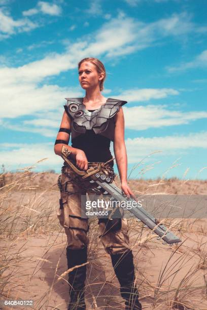 Futuristic Female Warrior Standing In The Desert