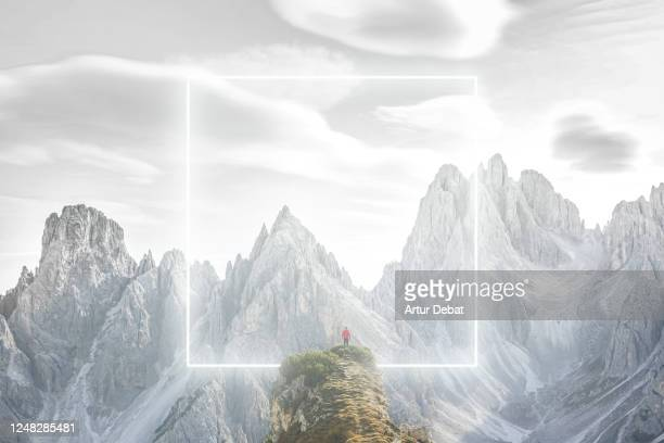 futuristic gate made with neon light with hiker in the alps mountains. - concept stock pictures, royalty-free photos & images