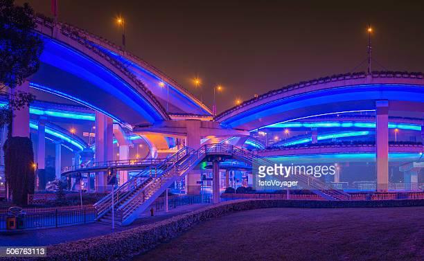 futuristic highway neon night illuminated bridges curving shanghai china - vehicle light stock photos and pictures