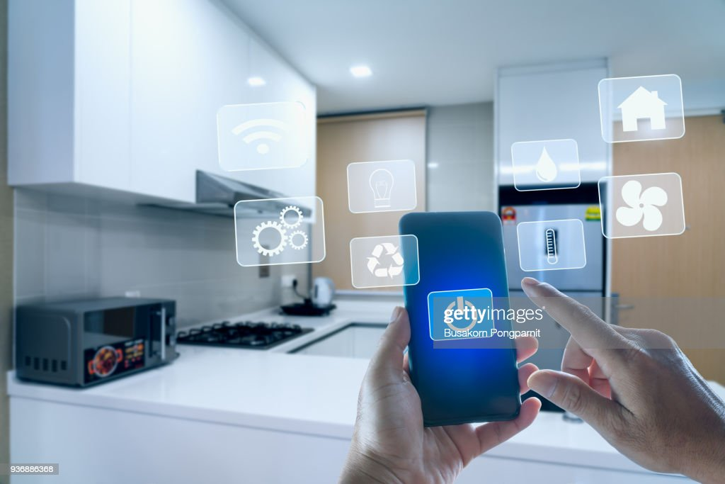 futuristic interface of smart home automation assistant on a virtual screen and a user touching a button : Stock Photo
