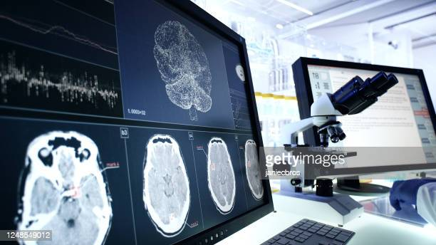 futuristic laboratory equipment. brainwave scanning research on computer screens - scientific imaging technique stock pictures, royalty-free photos & images