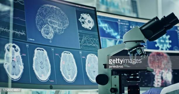 futuristic laboratory equipment - coronavirus testing. studying virus damage to the brain - brain  stock pictures, royalty-free photos & images