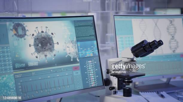 futuristic laboratory equipment - fighting with coronavirus - genetic mutation stock pictures, royalty-free photos & images