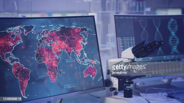 futuristic laboratory. high infectivity level on world map. scanning dna mutations - pathogen transmission stock pictures, royalty-free photos & images