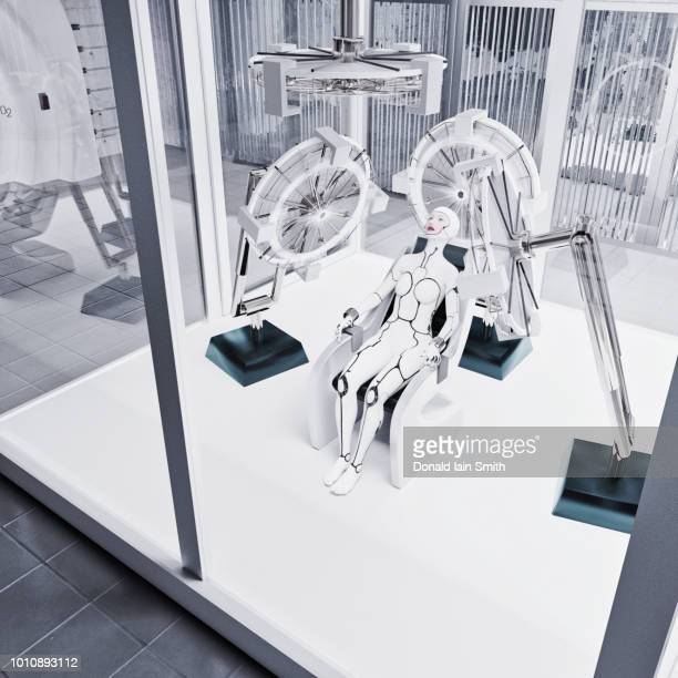 futuristic laboratory with female white cyborg sitting in chair with hand straps inside glass chamber - strap stock pictures, royalty-free photos & images