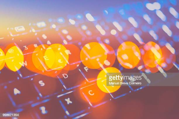futuristic laptop keywoard - finance and economy stock pictures, royalty-free photos & images