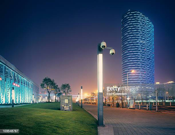 Futuristic lit building and surveillance camera's